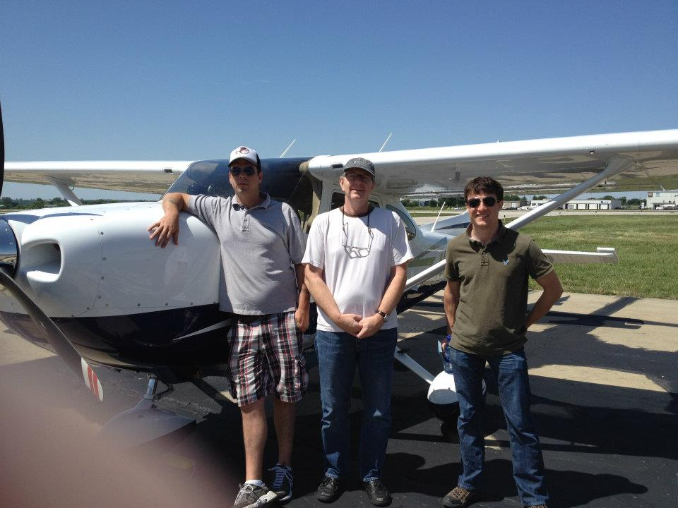 Caleb Elliott, Phil Bates and Skip Talbot in front of the Cessna 182.