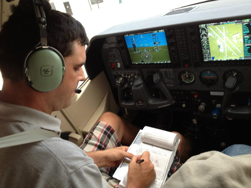 Caleb Elliot checking the flight plan.
