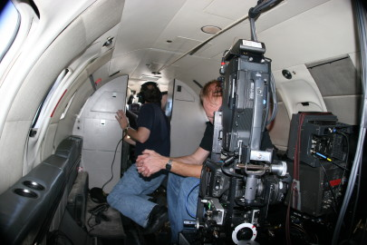 Inside the cabin of the Learjet, I found it easiest to direct by communicating directly with the pilot and pointing where I wanted him to go. In the foreground the camera technician monitors the Vectorvision camera (another F900) pointing down and out the belly of the aircraft.