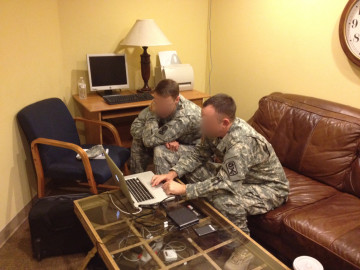 Army intelligence officers looking over our footage.