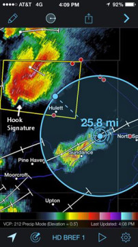 "Tornados typically form under the updraft base of a supercell thunderstorm. This is typically seen as a cloud lowering on the southern portion of the storm. As the base begins to rotate, a ""hook"" shape often forms on radar. This is a radar image of the storm taken from my phone as we made our approach (Yes, there's an app for that!)."