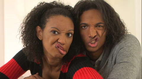 RC-FH232-134 - Young couple making faces