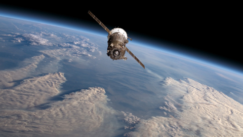 RBL212 - Space satellite above thick clouds of Earth's atmosphere