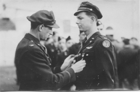 Lt. Ralph Bates receiving his flying wings.