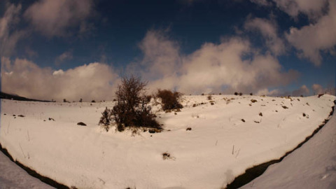 Time-lapse clouds passing over snowy Golan Heights