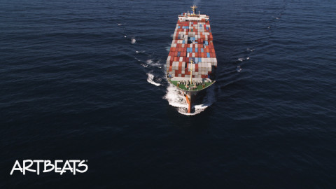 004-C078: Close flight over a container ship in open ocean.