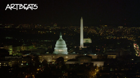 A122-C050B: Orbiting Capitol Hill at night; Washington Monument and Lincoln Memorial in rear, Library of Congress in left foreground as clip ends.